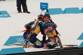 Canadian and American skiiers embracing after a tough ski