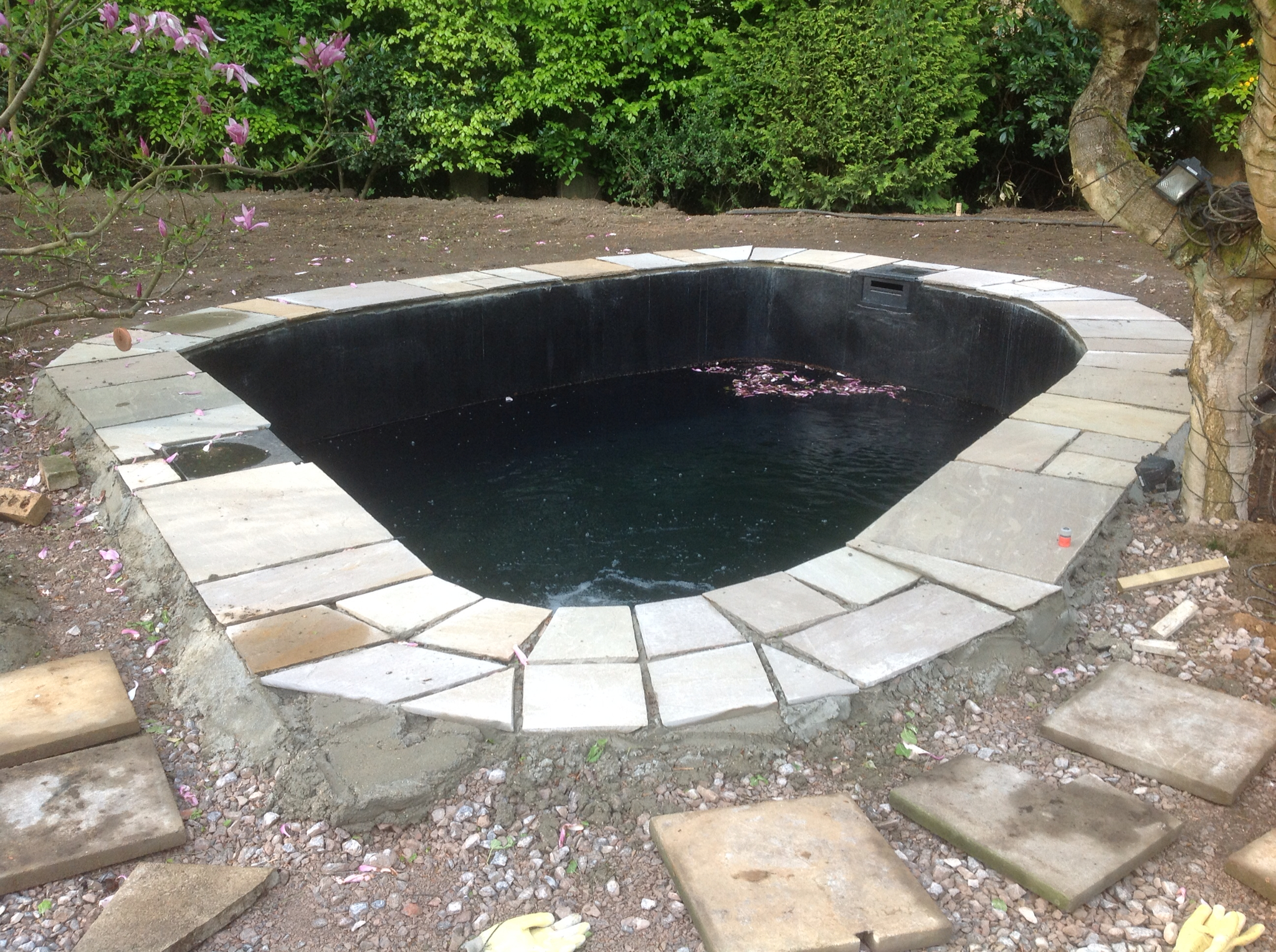 Mark hobden main koi pond build pond edge slabs down for Garden pond edging