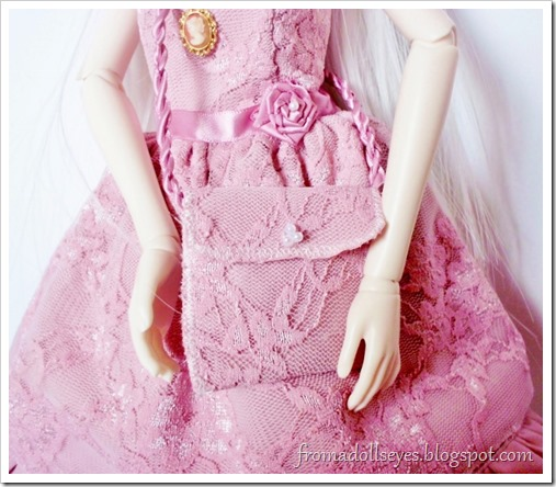 Pink lace doll purse to match the dress.