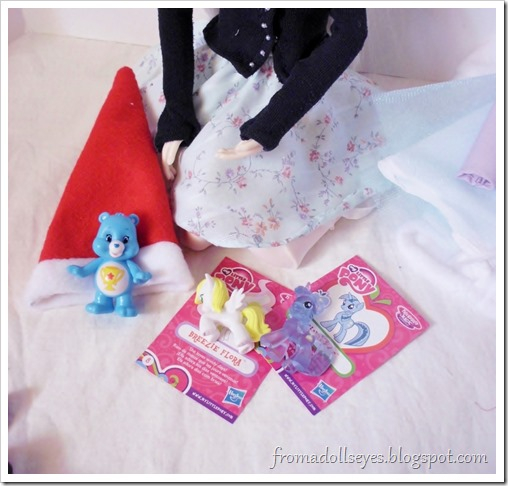Sorting doll clothes and accessories.