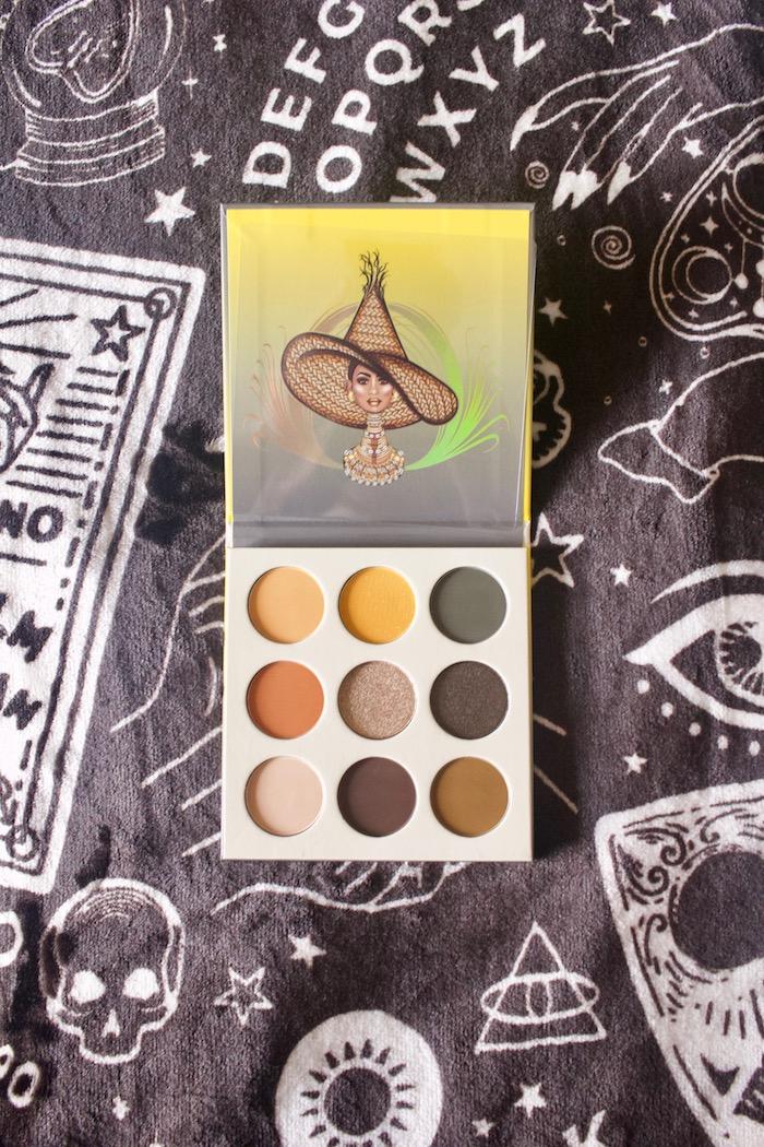 eyeshadow palette open on top of Halloween shapes blanket