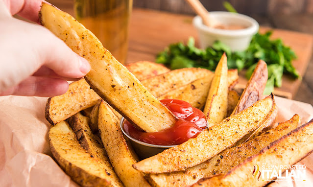 dipping Copycat Red Robin Fries in ketchup