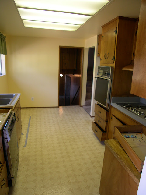 The Small Enclosed Kitchen Before