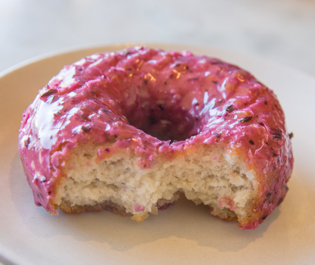 close-up photo of a Huckleberry donut with a bite taken out of it