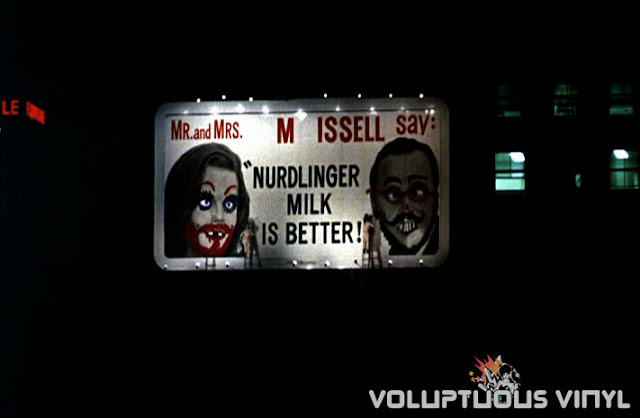 Nurdlinger Milk defaced billboard from the film Good Neighbor Sam
