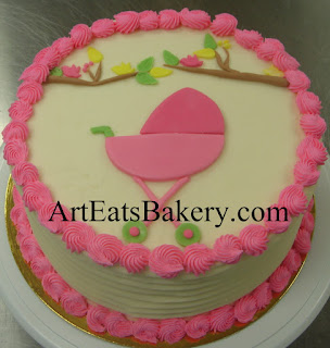 Girls baby shower pink, white and yellow butter cream cake with fondant stroller, birds and leaves design idea picture