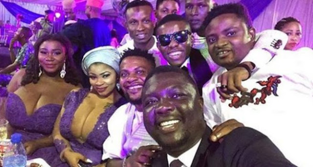 Comedian Seyilaw Pictured With Busty Ladies At Oritsefemi's Wedding