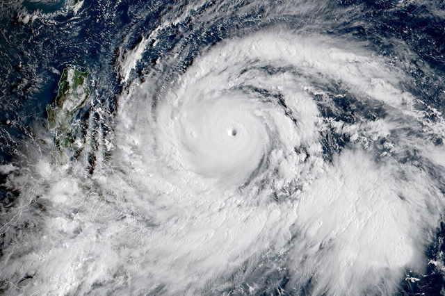 A satellite image of Super Typhoon Mangkhut near the Philippines early Thursday, 13 September 2018. Photo: National Oceanic and Atmospheric Administration / Agence France-Presse / Getty Images
