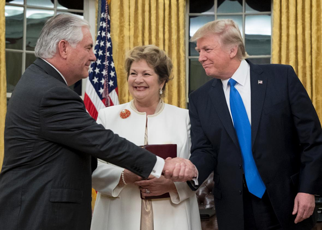 President Trump shakes hands with Rex Tillerson after Tillerson was sworn in as secretary of state, as Tillerson's wife, Renda St. Clair, looks on. Photo: Michael Reynolds-Pool / Getty Images