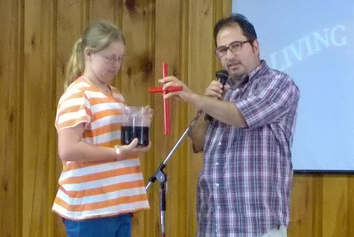 "This camper was helping me with a very cool gospel illustration called ""The Chemical Cross."""