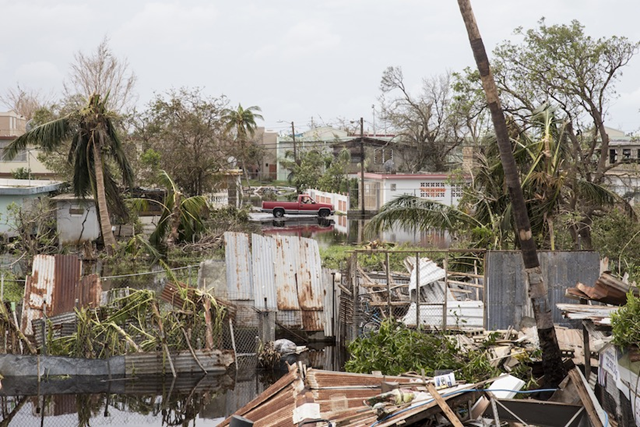 Destruction is seen days after Hurricane Maria made landfall, on 22 September 2017 in Loiza, Puerto Rico. Many on the island have lost power, running water, and cell phone service after Hurricane Maria, a category 4 hurricane, passed through. Photo: Alex Wroblewski / Getty Images