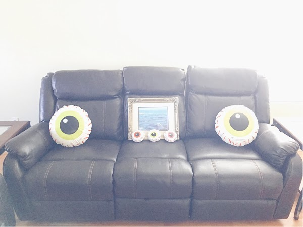 A living room decorated for the dead