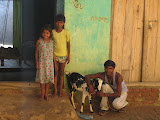Village children with the family goat.