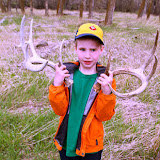My son gawks at a beautiful matched pair of whitetails sheds picked up by a friend of a friend.