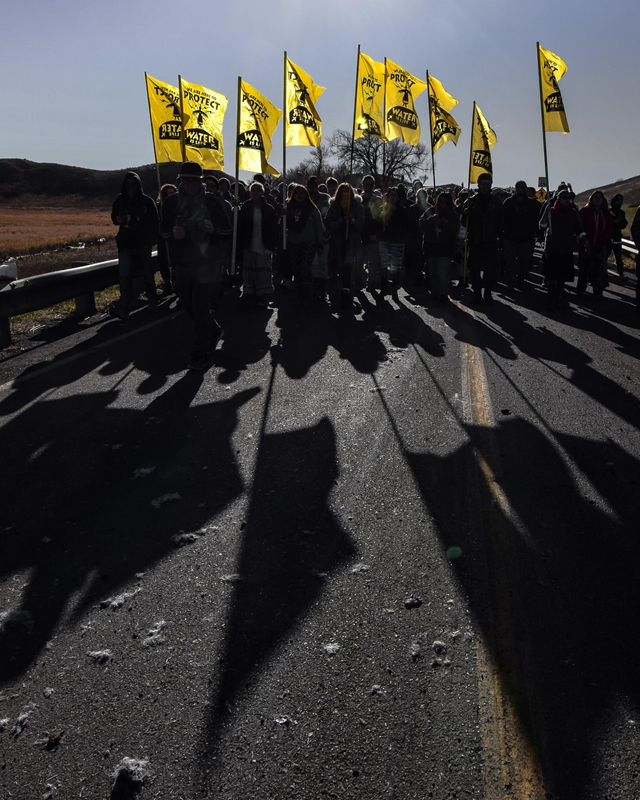 Standing Rock Sioux water protectors, 'Oceti Sakowin', march against the Dakota Access Pipeline project, 13 November 2016. Photo: Redhawk / Standing Rock Rising