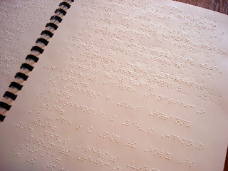 a page of Braille from the book of Romans
