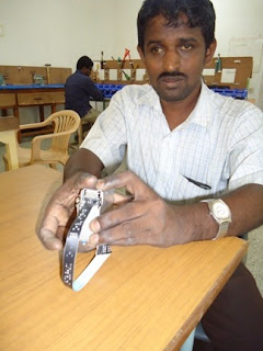 Govindaraj, a blind man who works at the Blind-Lead facility in Tamilnadu, demonstrates operation of a Braille-It labeler that he has constructed independently.