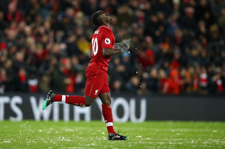 Sadio Mane of Liverpool celebrates after scoring his team's first goal during the Premier League match against Leicester City at Anfield on Wednesday. They drew 1-1.