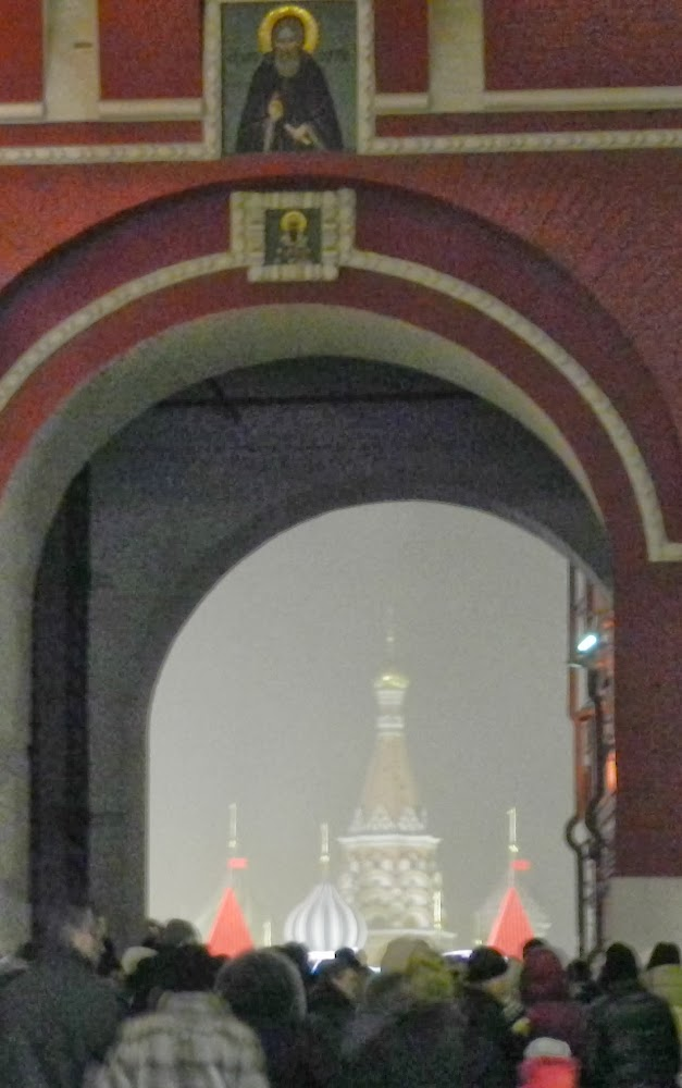 St. Basil's barely visible through the heavy crowds and falling snow