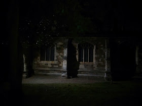 Spooky chuch and leaves at the dead of night