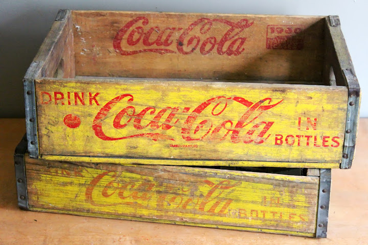 Yellow Coca-Cola crates available for rent from www.momentarilyyours.com, $4 each.