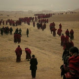 Lay people and monks walkin back to Kirti Monastery during Phuntsog's funeral