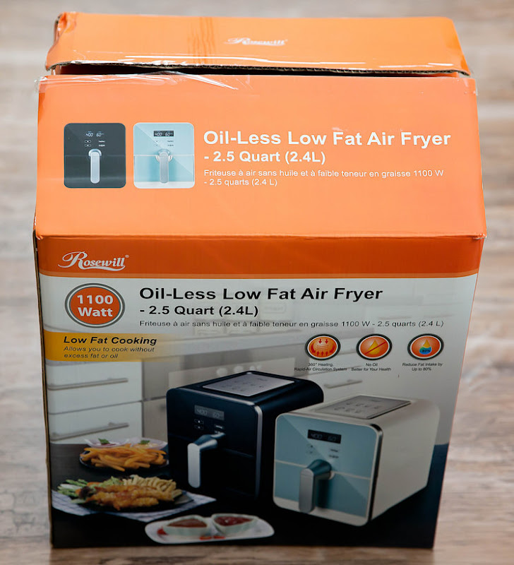 a photo of a Rosewill Oil-less low fat air fryer in a box