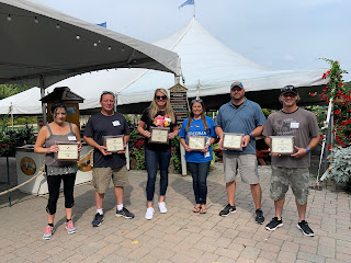 Corcoran Management Company employees posing with their 10 year plaques at Kimball Farm