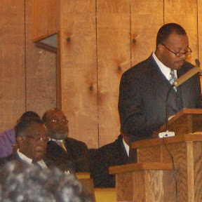 Rev Harrison leading worship
