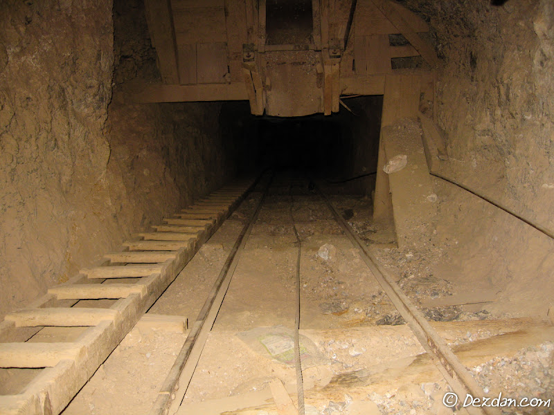 Looking down the incline an ore chute appears overhead.