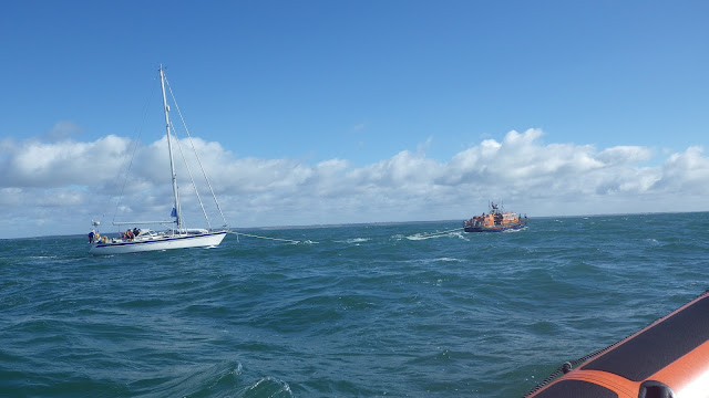 Poole ALB towing a yacht with engine and steering failure in Poole Bay on 11 May 2013. Photo: RNLI/Poole Alex Evans