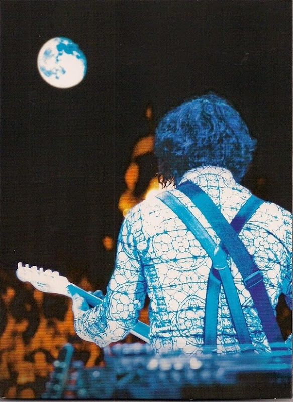 Jack White on stage with guitar at Bonnaroo 2014 with full moon in the sky.