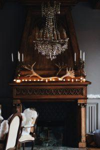 Vintage interior with fireplace and crystal chandelier