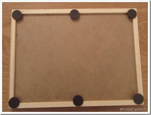 Self adhesive magnets on chalkboard