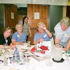 Helene holds up Auction money.  Roy Ellen is still adding.   Paula and Virginia Melton assist.
