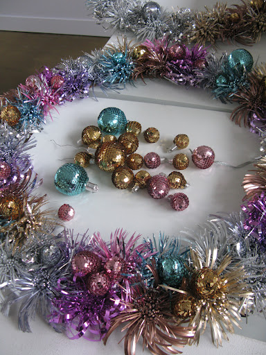 The finishing touch on the foil wreaths