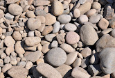 """Surge Rock - Also known as river rock, ranges in size from 2"""" to 9"""". Can be used in dry creek beds, or as landscaping rock."""