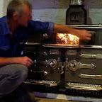 Lighting fire in restored oven.jpg