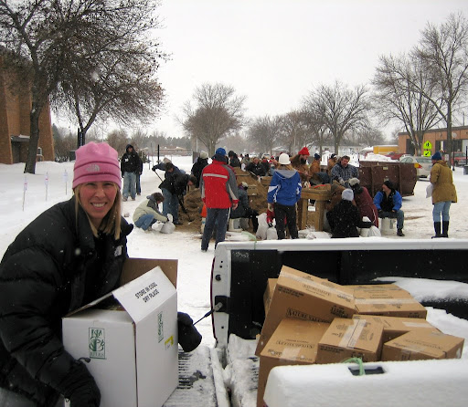 Jonell unloading hot chocolate and granola bars at Nemsek building. Volunteer center and sand bagging area