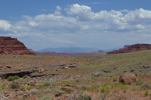 widening canyon with distant mountains visible