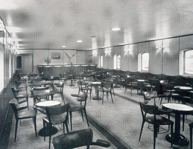 The lounge has modern steel-framed chairs with integral hatracks. From THE MARINE ENGINEER AND NAVAL ARCHITECT.jpg