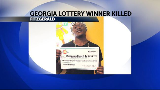 Seven arraigned for murder of lottery winner, young father