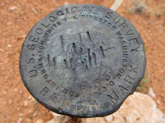 "Vandalized ""Spur 1953"" survey marker"