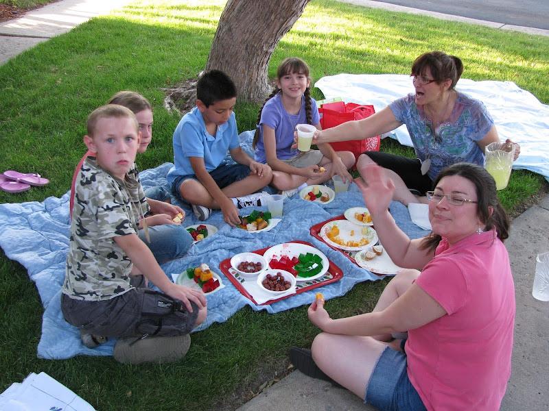 Kids and Volunteers Having Snacks