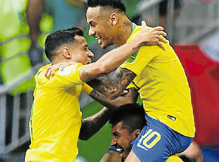 Brazil's star stiker Neymar celebrates scoring their first goal with teammates in their match against Mexico yesterday.