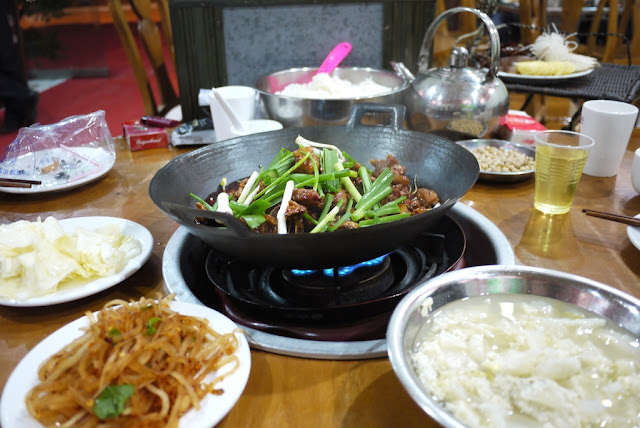 dry hot pot in front of a big metal bowl of rice in Guiyang, Guizhou