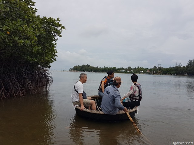 Explore Lang Co's beautiful lagoons and the local fishing village, navigating through the mangroves in a traditional basket boat.