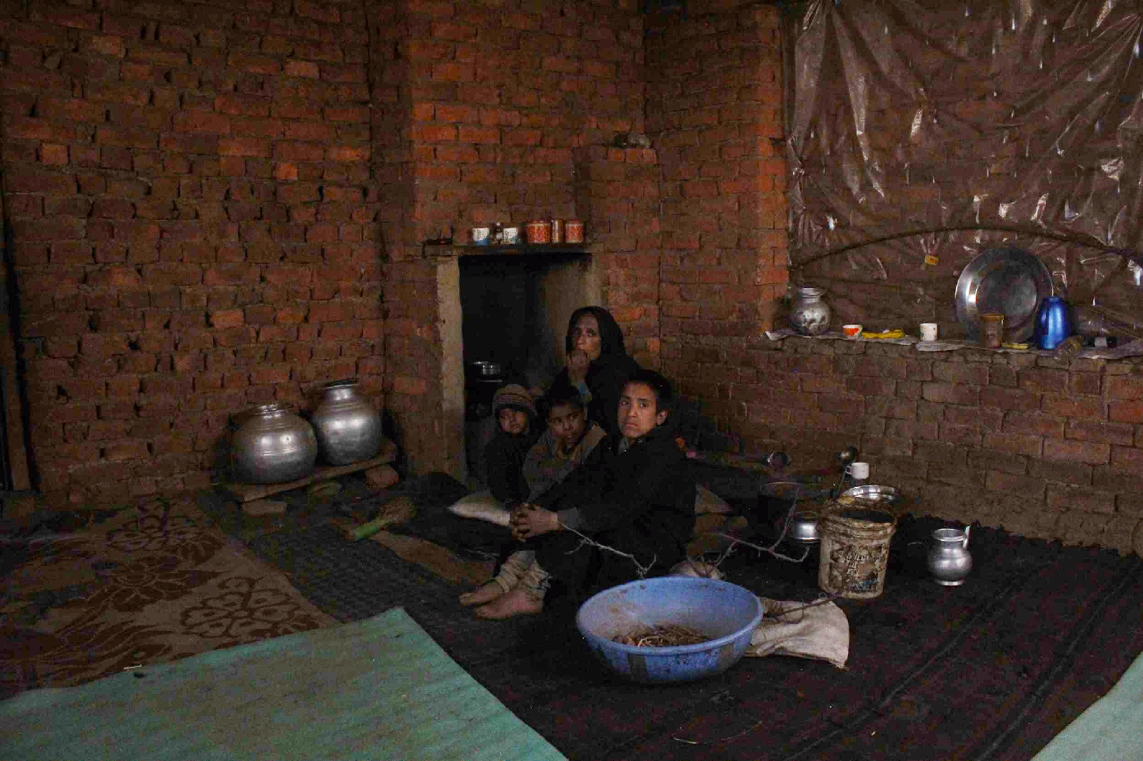 The family prepares their meals on traditional stove made of clay (called Daan in Kashmir) as they don't have any electricity connection.