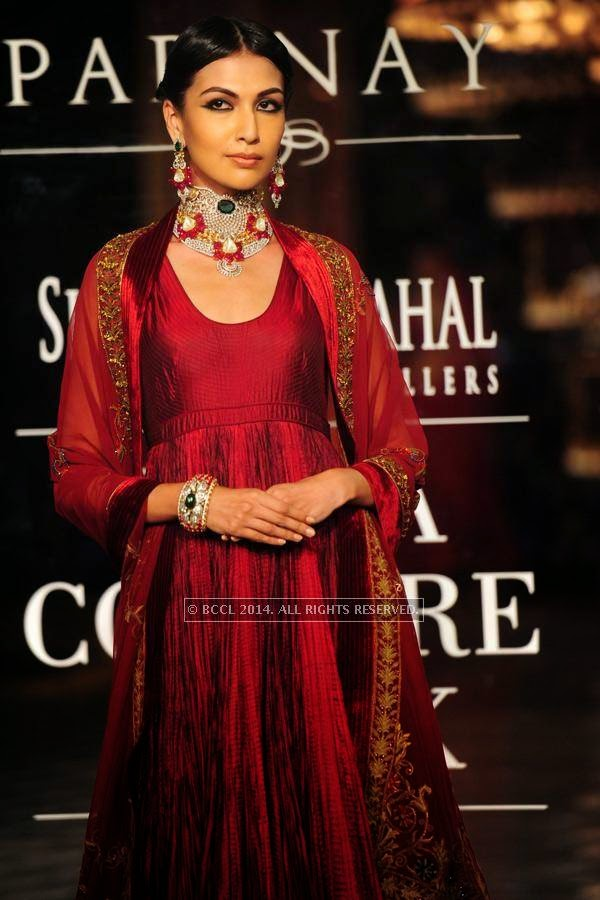 A model walks the ramp for Shree Raj Mahal Jewellers on Day 6 of India Couture Week, 2014, held at Taj Palace hotel, New Delhi.<br /> <br />