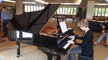 Denise Gunson playing the grand piano.